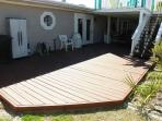 The large deck in the backyard is great for enjoying the sunshine and entertaining.