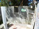Rinse off after a day at the beach in the large, fenced outdoor shower.