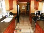 The kitchen is updated with beautiful granite countertops and stainless steel appliances.