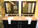 The master bath has a stand up shower and double vanity.