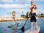 Try your 'SUP' skills on a stand up paddle board.