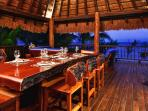 Outdoor dining under our palapa