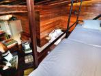 twin loft beds above suite #1 - popular with kids - accessible by ladder