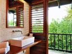 his and hers guest bathrooms adjacent to palapa/dining area