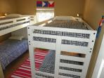This bedroom has 2 bunk beds for a total of 4 twin beds and shares a bath with bedroom 1.