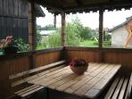 Open air eating area with view from the back of the house