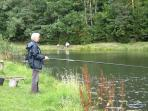 Fishing for trout at Czarci Jar hatchery on the headwaters of the River Drweca one km from the house