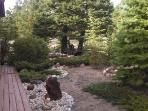 More views of beautiful landscaping in front yard.