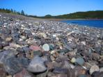 Jasper Beach, one of two beaches in the world consisting of smooth stones.