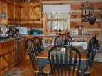 Open kitchen/dining area  - well equipped for your stay