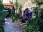 Patio garden with lovely fountain, sitting areas, night garden lighting