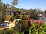Roof top terrace with stunning views in all directions; gardens; shade roof