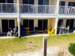 View of the patio, standing on the beach access. NEW patio furniture & NEW grill.