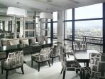 Gramercy's 36th Floor Restaurant-Cafe is a cozy & inviting space & a fantastic view of Makati City