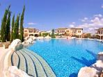 Take a dip in the wonderful communal pools at Theseus Village