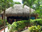 The garden palapa bar and kitchen has seating for 20