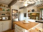 The kitchen in La Tuilerie is often a gathering place for family and friends!  Some even help!place