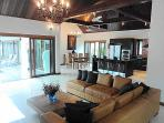 Our open plan living and dining area with floor to ceiling windows opening onto the pool and garden.