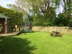The shared garden area and summerhouse