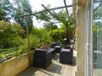 Terrace with vine canopy to enjoy the coolness from the stream