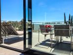 The Glass Balustrade Terrace Showing Your Outdoor Dining and Sunbath Area
