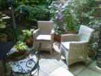 Rattan armchairs new June 1 2014.  Garden's looking great!