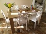 Dining area - large table and 6 chairs, access to larger patio