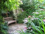 The garden has a variety of quiet spaces to sit