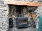 Traditional fireplace with log burner for evenings or cooler days.
