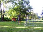 The Outdoor Play area with swings,slide,badminton net & others
