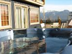 HUNTERS HAVEN: Take advantage of the huge private deck by soaking in the hot tub and taking in the spectacular mountain ...