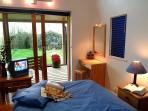 Cosy double bedroom looks out over the garden