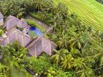 The aerial shot of Villa Natalie. One bedroom suite each side and living in the middle. Rice views.