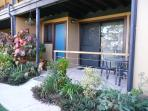 Private entrances and glass sliding doors to furnished Patios from all bedrooms.