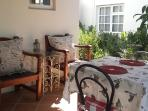 Sheltered patio, ideal for breakfast or watching the sunset over the mountains