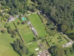 Aerial view of Galloway House Estate walled garden, Orchard, Pavilion, Shore Cottage. Beach to right