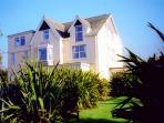 Yellow Sands Holiday Apartments in Harlyn Bay - detached Edwardian house in gardens, close to beach.