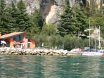 Tignale harbor with bar