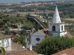 Walk round the ancient walled city of Obidos