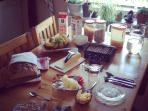 Full breakfast with fresh fuits, homemade jams and freshly baked bread