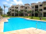 The apartment's pool is just steps away, and surrounded by the exquisite terraced gardens