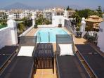 Sun beds and a small private pool on the roof terrace