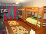 Bunk BR Each bunk also has pullout trundle for a total of 6 twin beds. 50' HDTV & Queen sleeper also