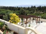 Villa Rosaria dining and barbeque terrace from upstairs balcony.
