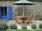 Rear terrace with lavender border, table & chairs for 6.