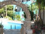 Nice stone archway leading to the pool