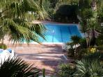 Large pool area with plenty of sunbeds