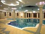 Heated inside swimming pool and spa
