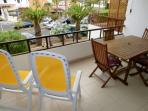 Spacious Balcony for alfresco dining with table and seating for up to 5 guests.