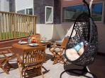 THE SUNNY TERRACE WITH 'BIRDS NEST' HANGING CHAIR